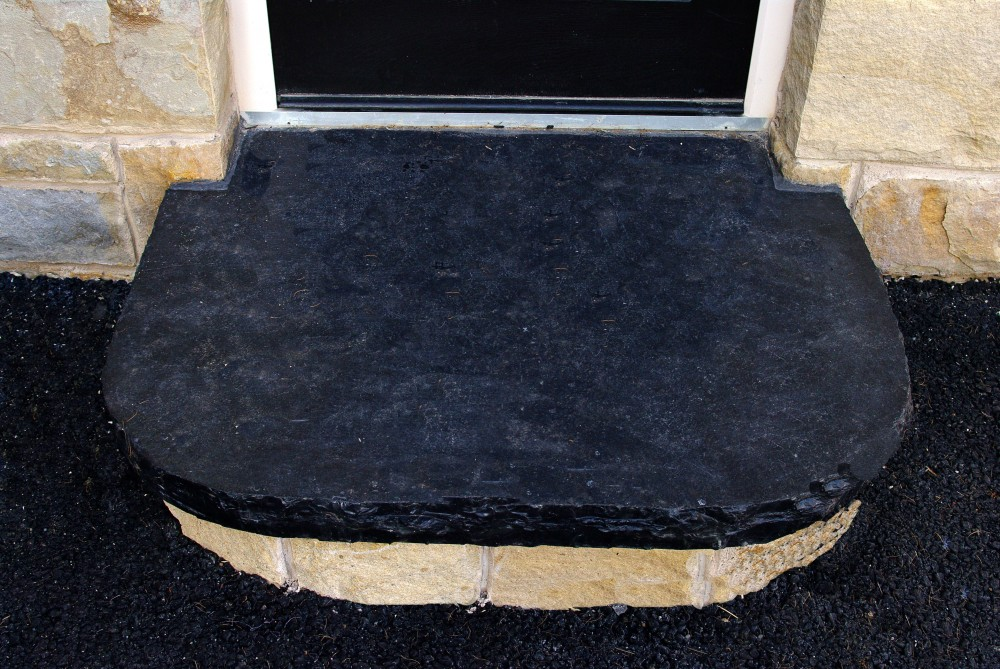 Indian limestone hearth used to form step with sandstone riser