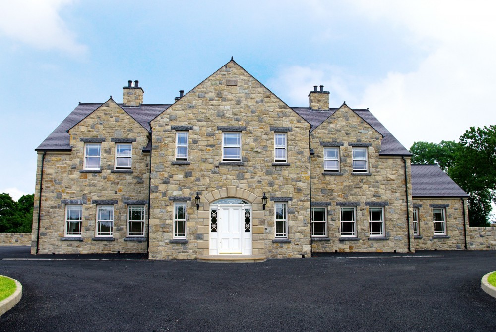 Donegal, Omagh & Blue Centred sandstone with rock faced Indian limestone cills and lintels