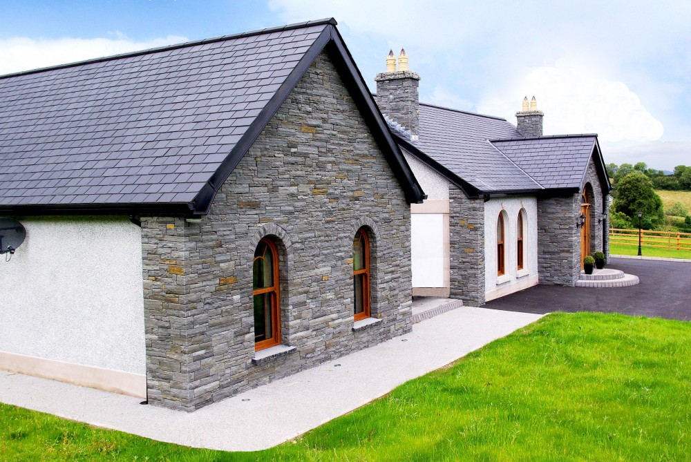 Dry built Liscannor stone with free standing window arches & 60mm Indian limestone hearths cut as window cills