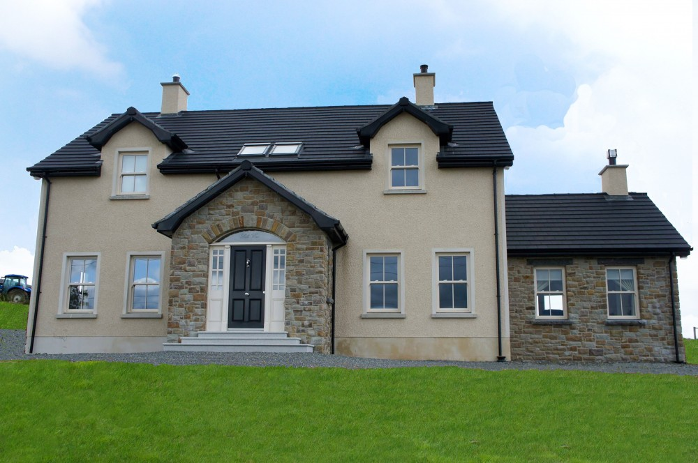50% Tipperary Brown & 50% Tipperary Blue. Free standing door arch. Bullnosed granite steps and risers