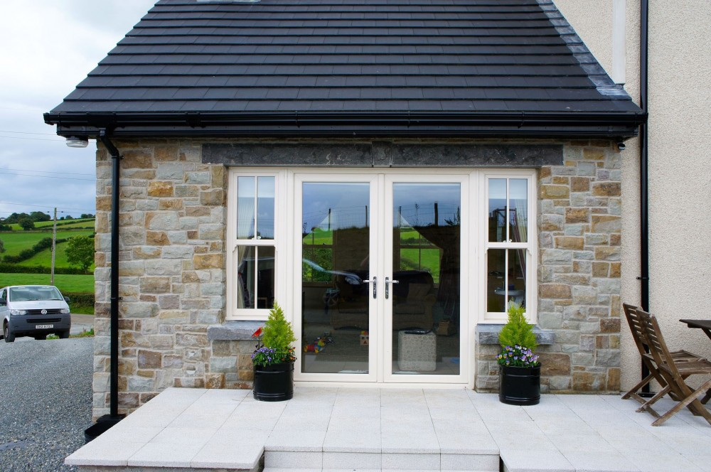 50% Tipperary Brown & 50% Tipperary Blue. Rock faced limestone window cills and lintels. Grey granite paving