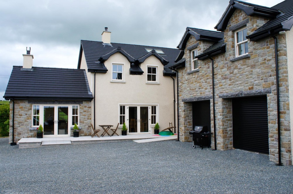 50% Tipperary Brown & 50% Tipperary Blue. Rock faced limestone window cills and lintels