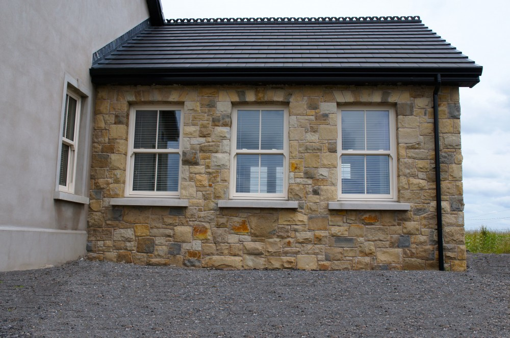 House Built with 70% Omagh Sandstone, 20% Donegal Sandstone & 10% Blue Centre Sandstone with self supporting flat arches and concrete window cills