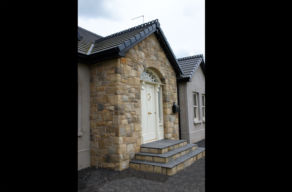 House Built with 70% Omagh Sandstone, 20% Donegal Sandstone & 10% Blue Centre Sandstone. Free standing door arch. Limestone flags users as doorstep treads finished with sandstone risers