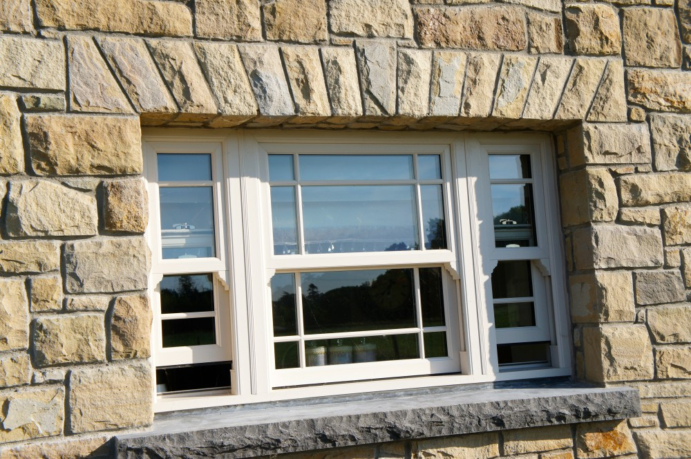 Freestanding flat arch. Rock faced limestone window cill