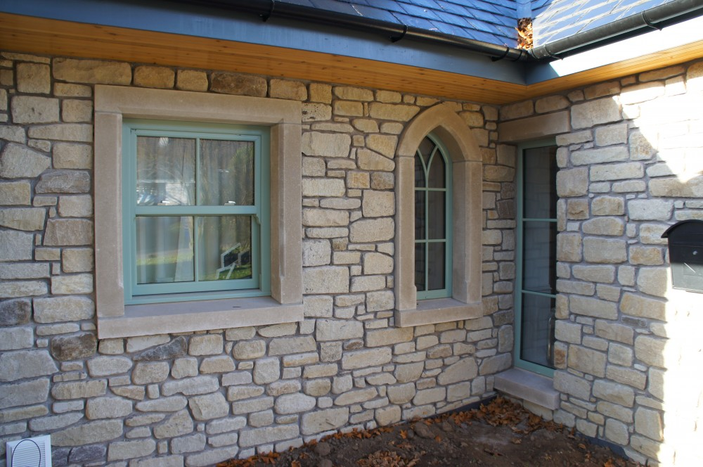 Reconstituted window surrounds and cills supplied by Craft Stone