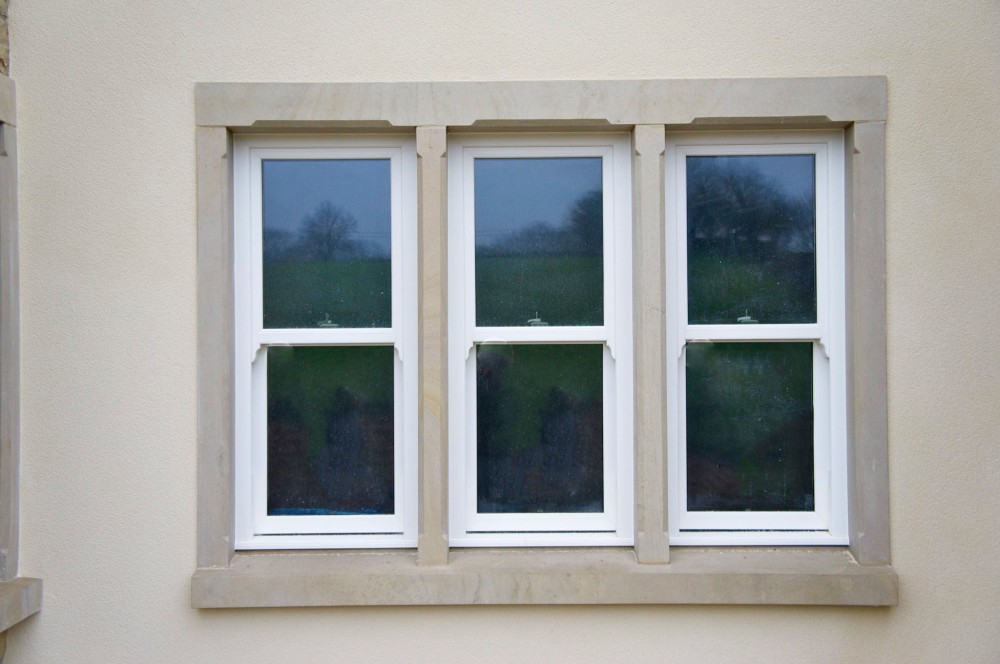 Donegal sandstone window surround with centre mullion