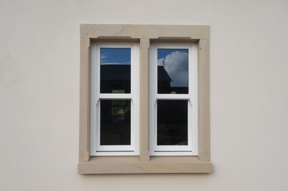 Donegal sandstone window surround fitted to rendered areas