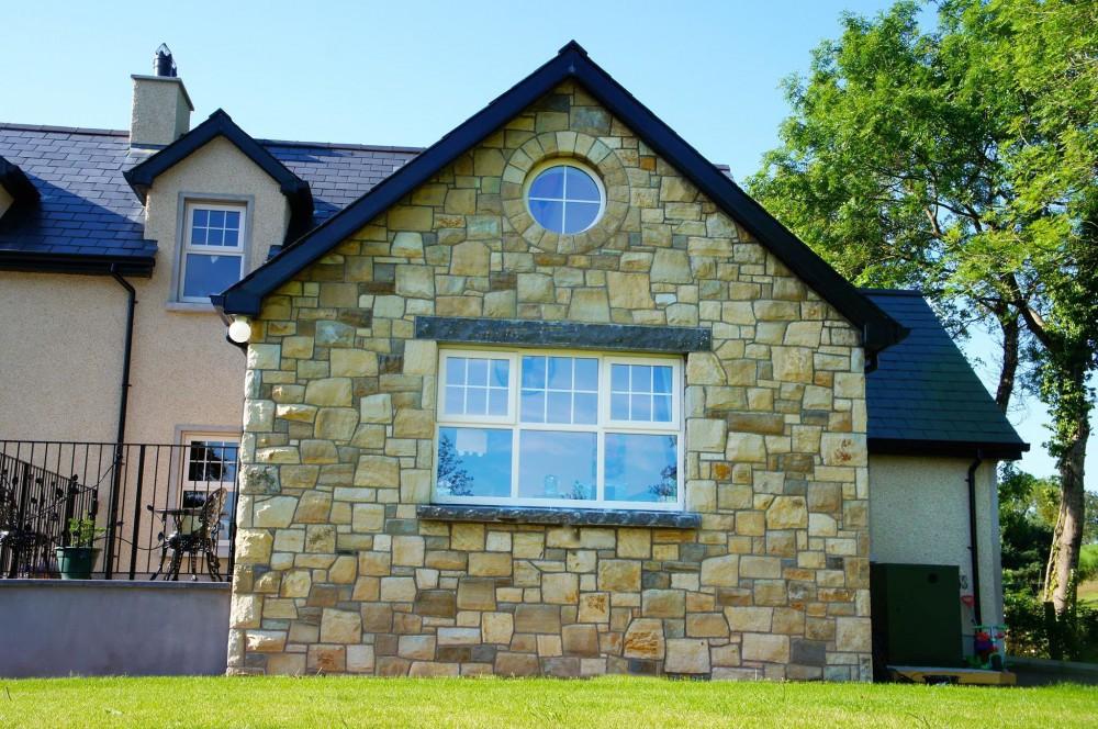 Rock faced limestone window cill and lintel