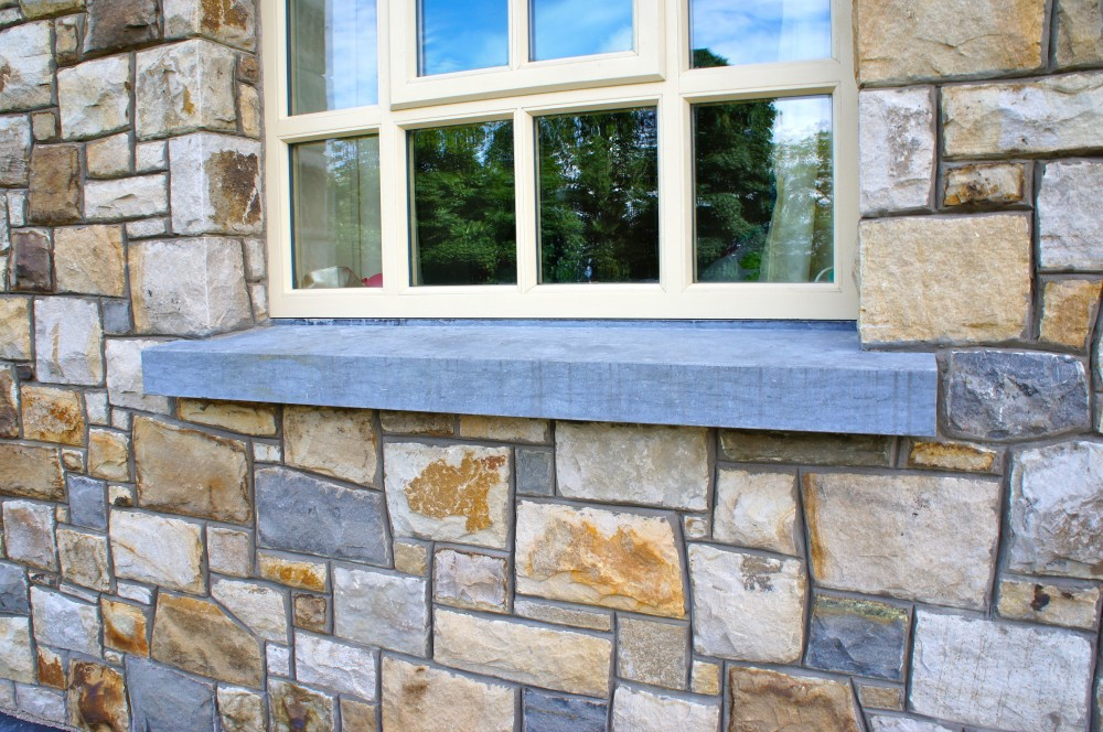 Smooth limestone window cills