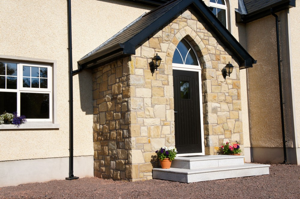 Free standing arch on front door. Grey granite steps