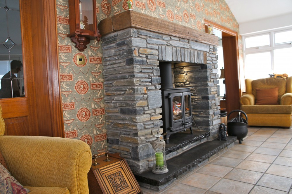 Donegal slate with split level black limestone hearth