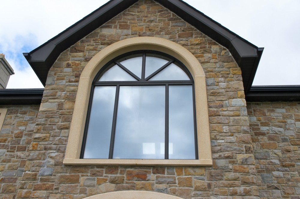 Reconstituted granite arched window surround
