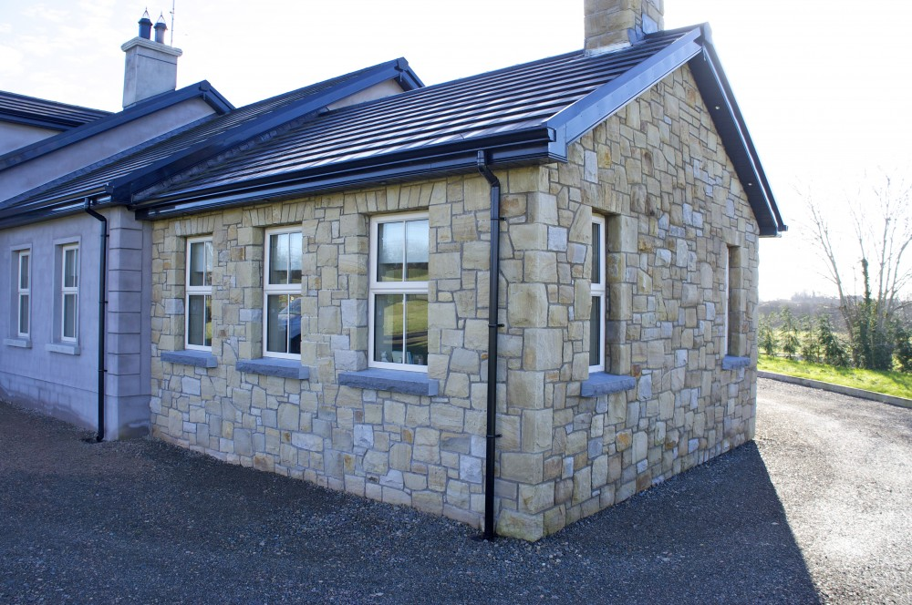 Rock faced limestone window cills and soldiers built on Keystone lintel
