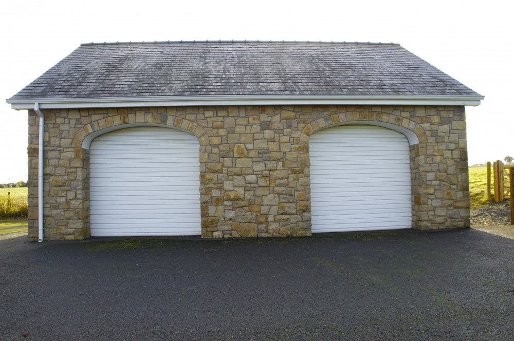 Garage door arches built on keystone lntels