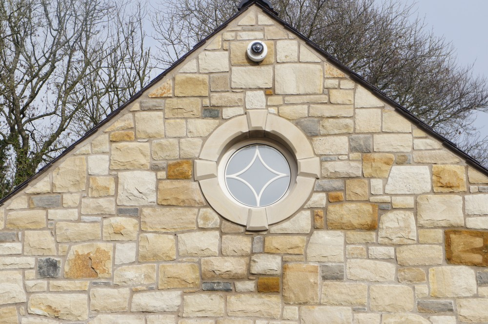 Donegal Sandstone surround on round window