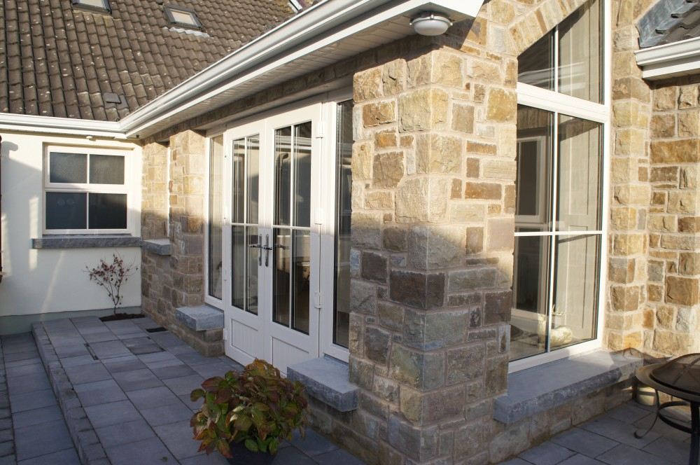 Tipperary brown sandstone with rock faced limestone window cills
