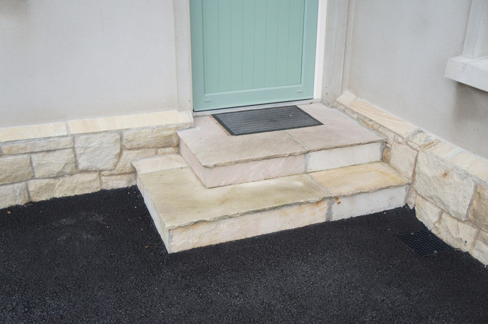Steps formed using tinted mint treads and risers