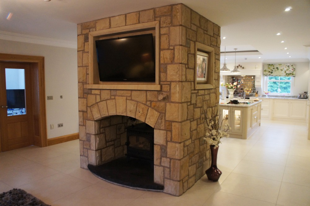 Curved rock faced limestone hearth