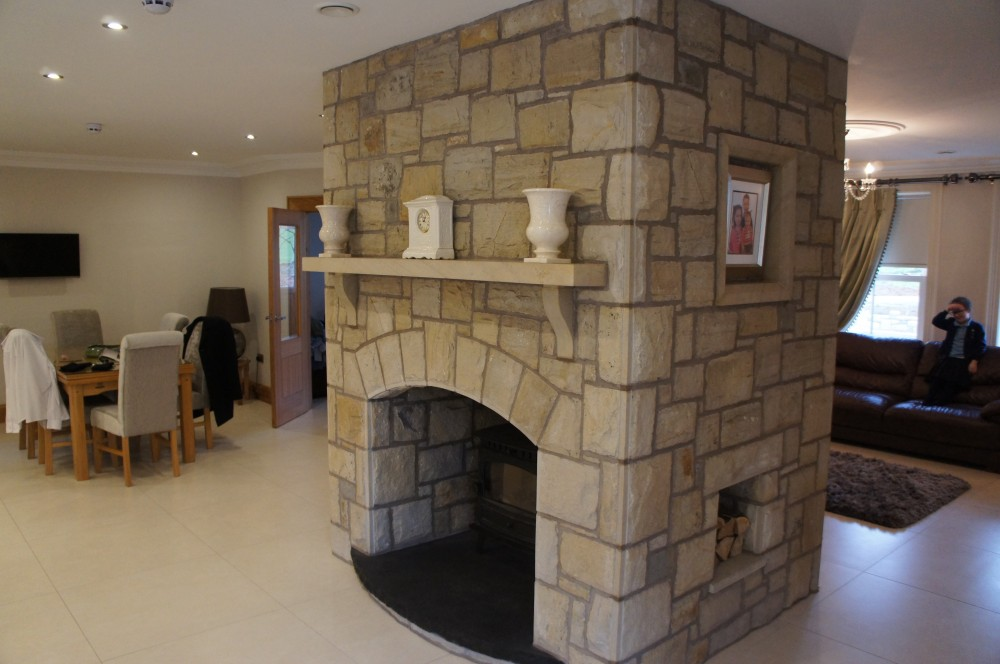 Double sided fireplace built with mix of Donegal, Omagh and blue centred sandstone.