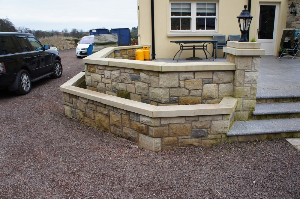 Sawn and polished Donegal sandstone wall copings. Donegal sandstone double layered pier cap