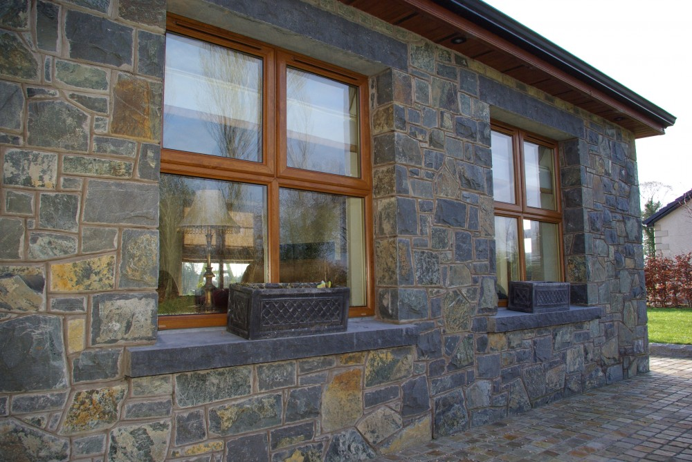 Rock faced limestone window cills and lintels