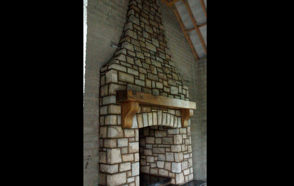Mix of Tipperary brown and blue sandstone with wooden mantle with free standing arch