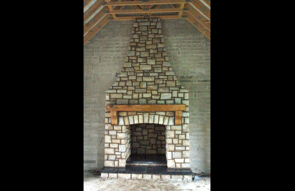 Mix of Tipperary brown and blue sandstone with wooden mantle