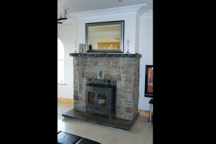 Green Portlaoise Stone. Coned Corbel Detail. Rock Faced Limestone Mantle And Hearth With 3 Piece Self Supporting Flat Arch