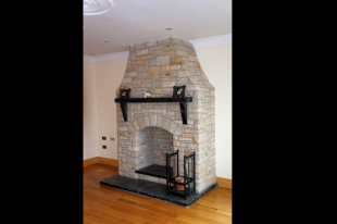 Donegal Quartz With Split Level Black Limestone Hearth And Limestone Mantle And Corbels