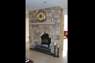 Double Sided Fireplace In Donegal, Omagh And Blue Centred Sandstone With Rock Faced Sandstone Mantle And Corbels. Split Level Rock Faced Black Limestone Hearth