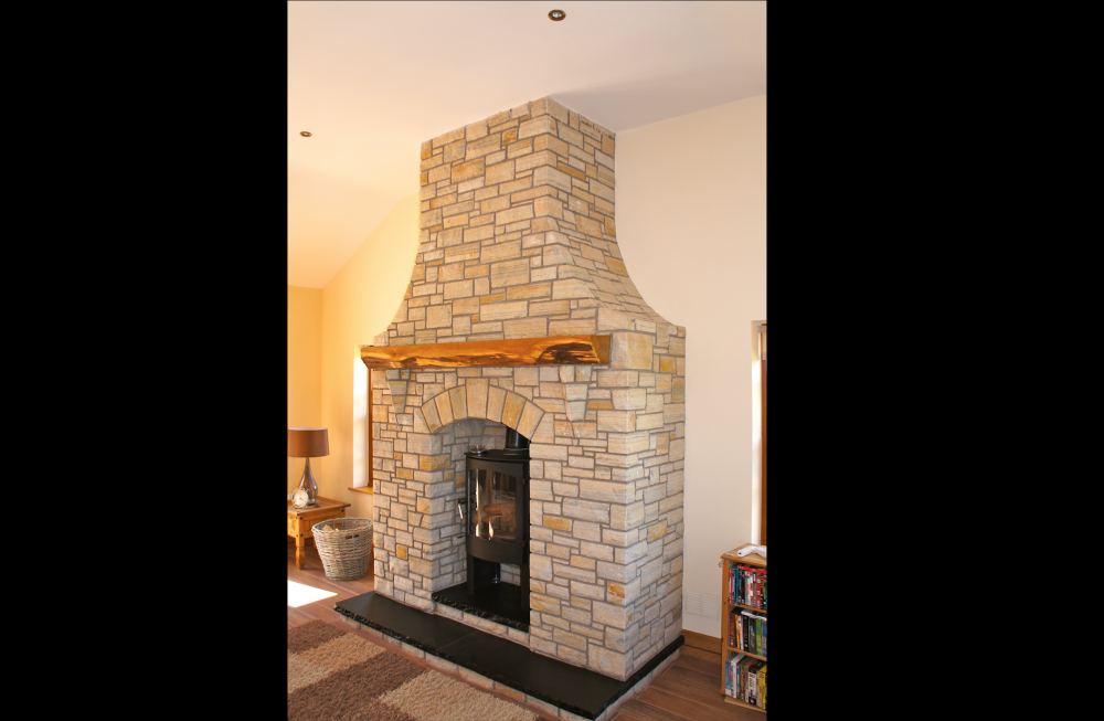 Donegal quartzite with free standing arch and split level black limestone hearth