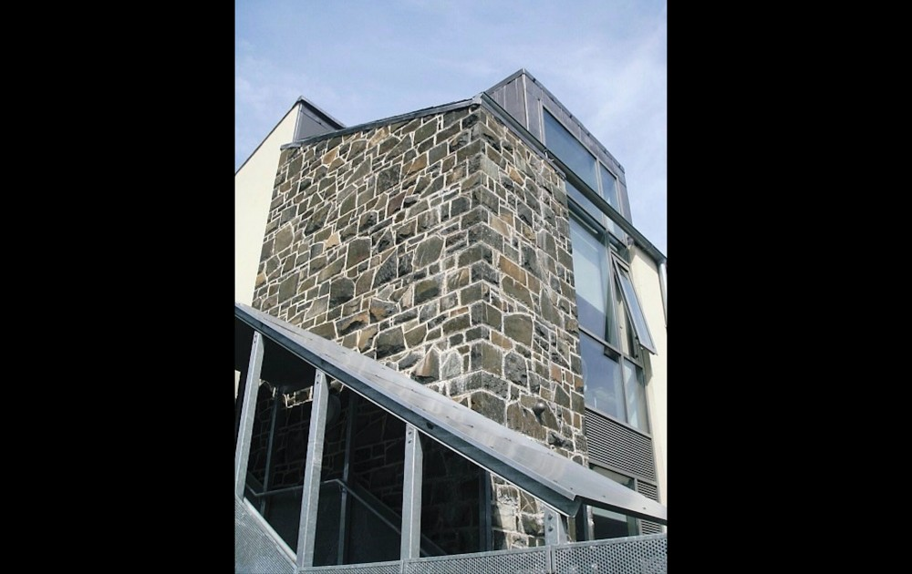 Mix of 50% split and 50% natural faced Basalt coursed building