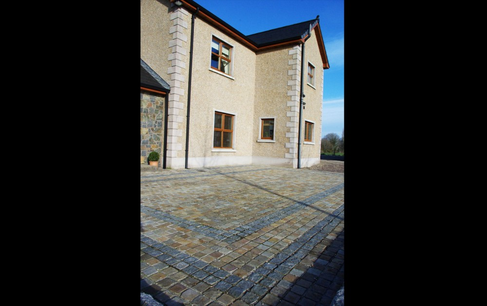 Brown cobbles with black limestone cobble border