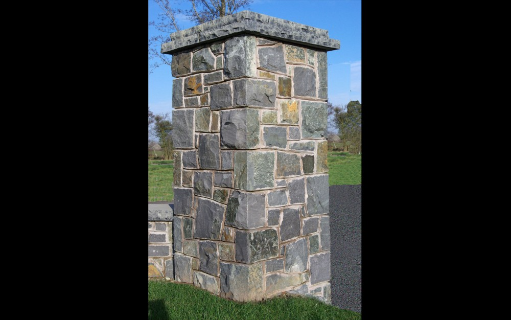 Pillars formed from multi coloured basalt with a rock faced limestone double layered pier cap