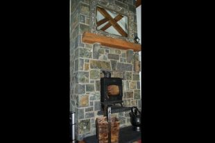 Multi Coloured Basalt Fireplace With Rock Faced Limestone Hearth