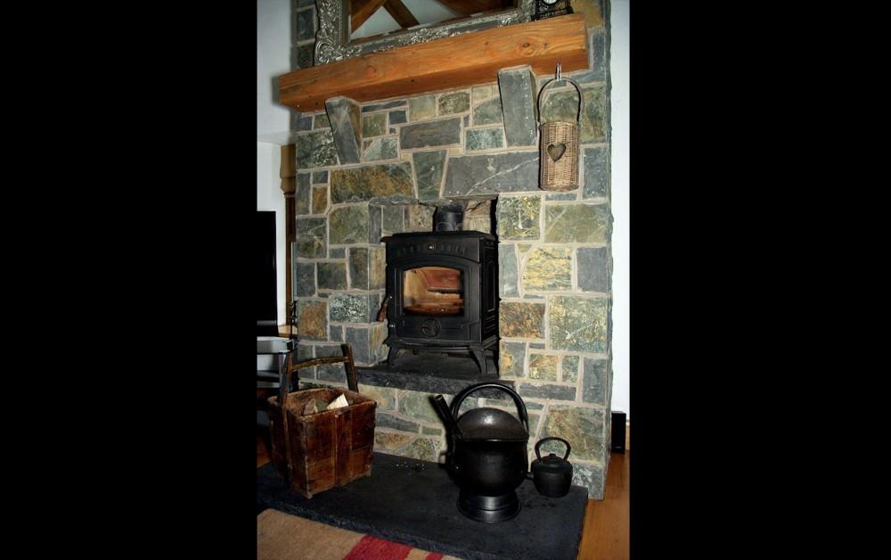 3 piece free standing flat arch on fireplace. Limestone corbels