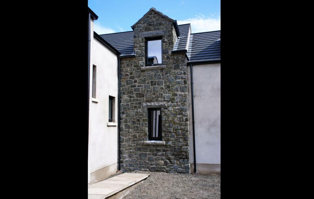 Rock faced limestone window cills and lintels