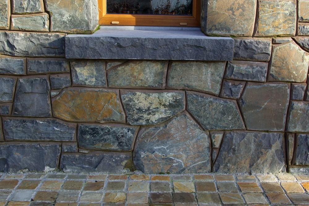 Rock faced limestone window cill