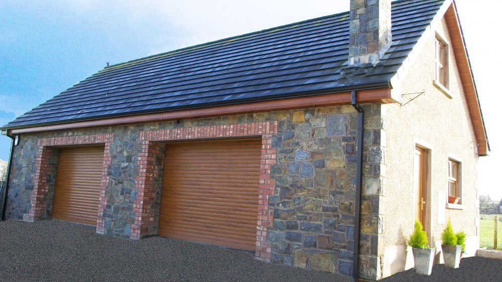 Red brick quoin and arch detail to garage door openings