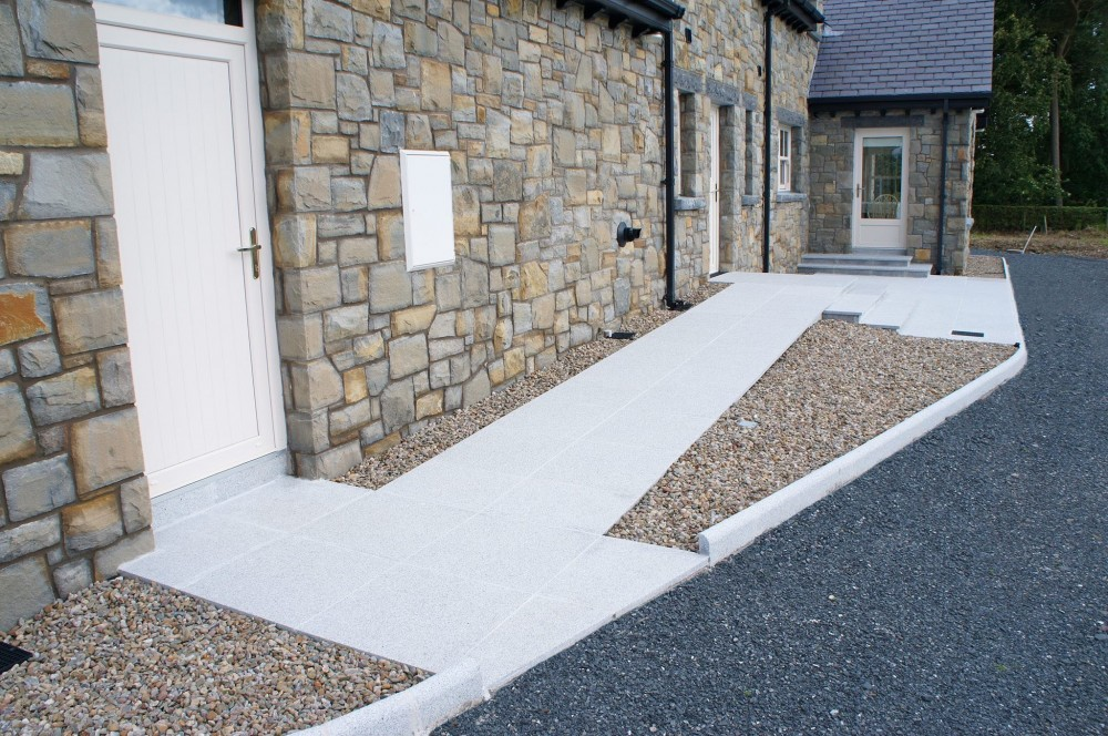 Disabled access ramp formed using silver granite paving