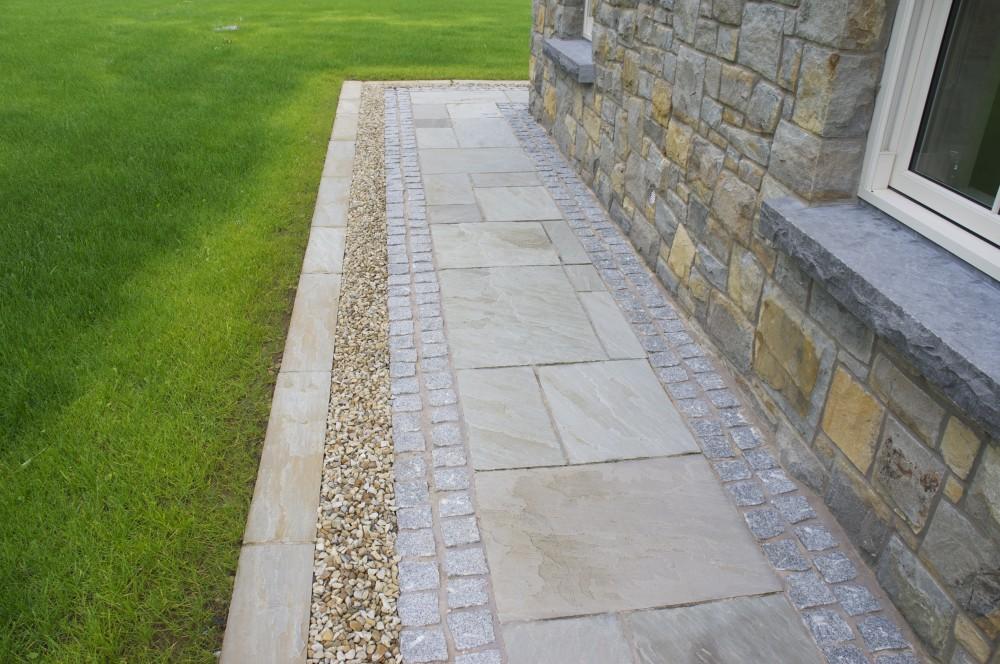 Kandla Grey paving with grey granite cobble border