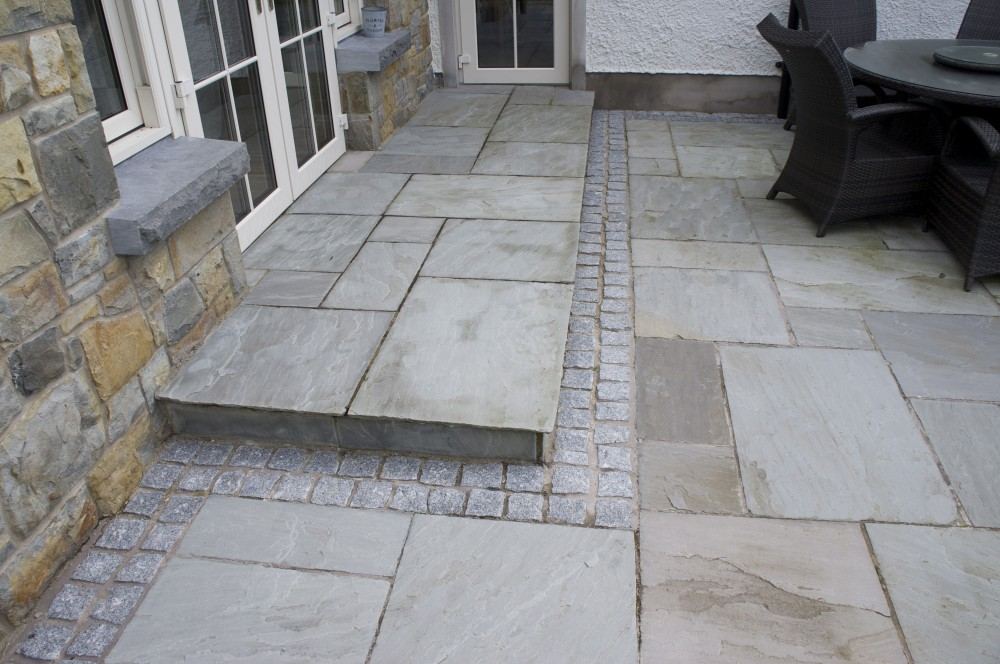 Kandla Grey Paving With Grey Granite Cobble Border