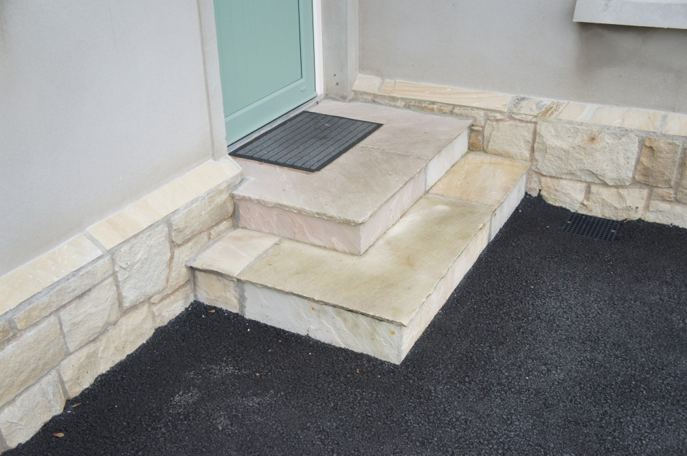 Steps & risers formed from tinted mint paving