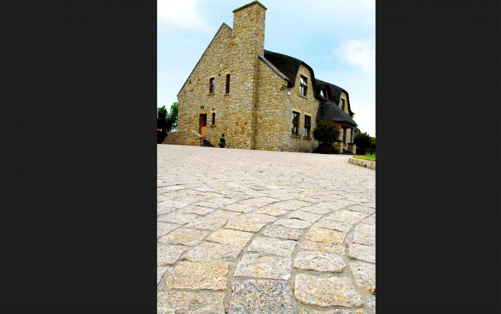 Gold granite cobbles