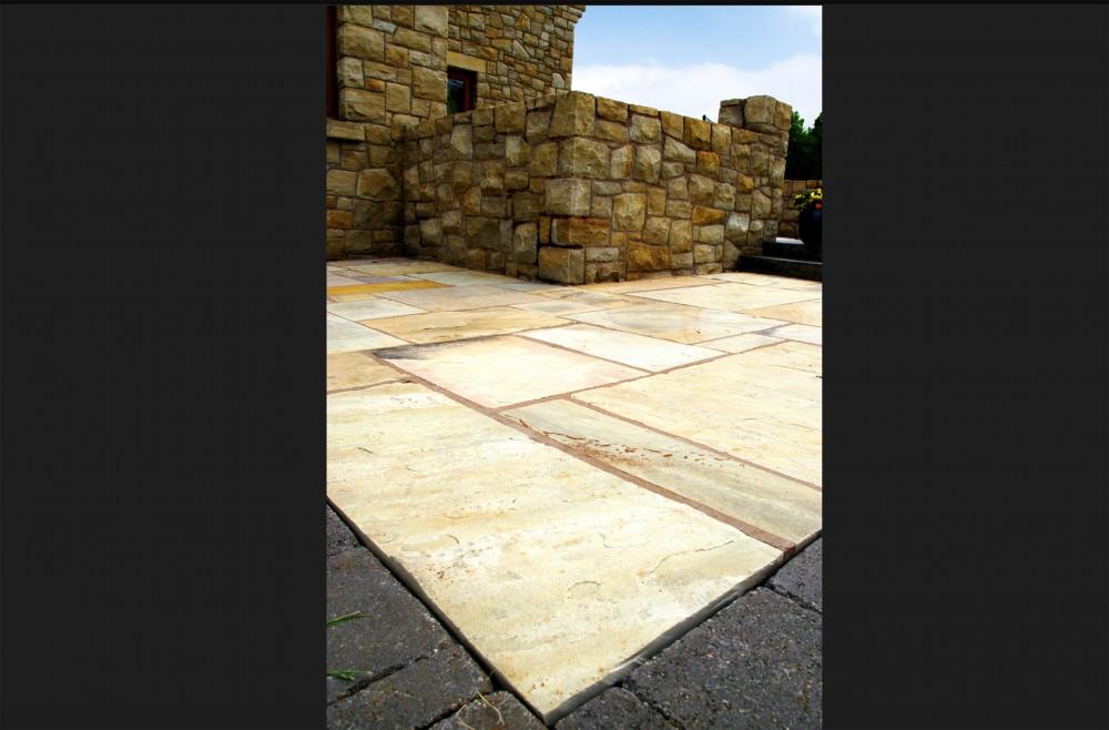 Tinted mint paving with black limestone cobble border
