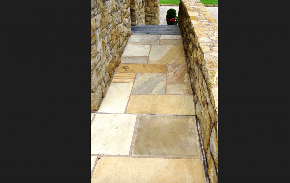 Tinted Mint Paving With Black Limestone Cobble Border