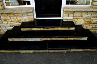 Steps Formed Using Black Limestone Treads And A Stone Riser
