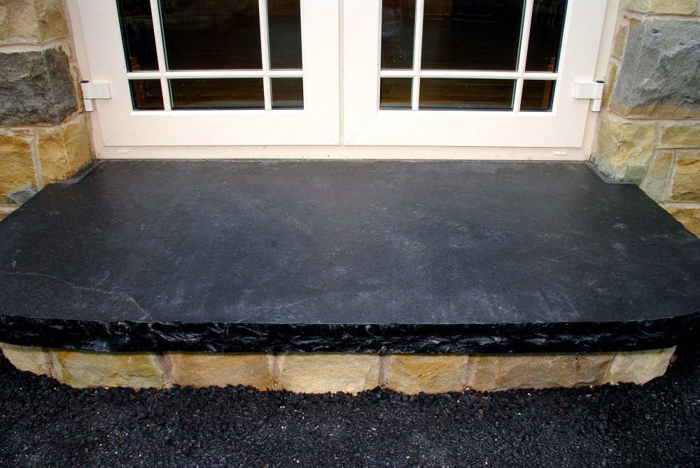 Limestone hearth used to form step with sandstone riser