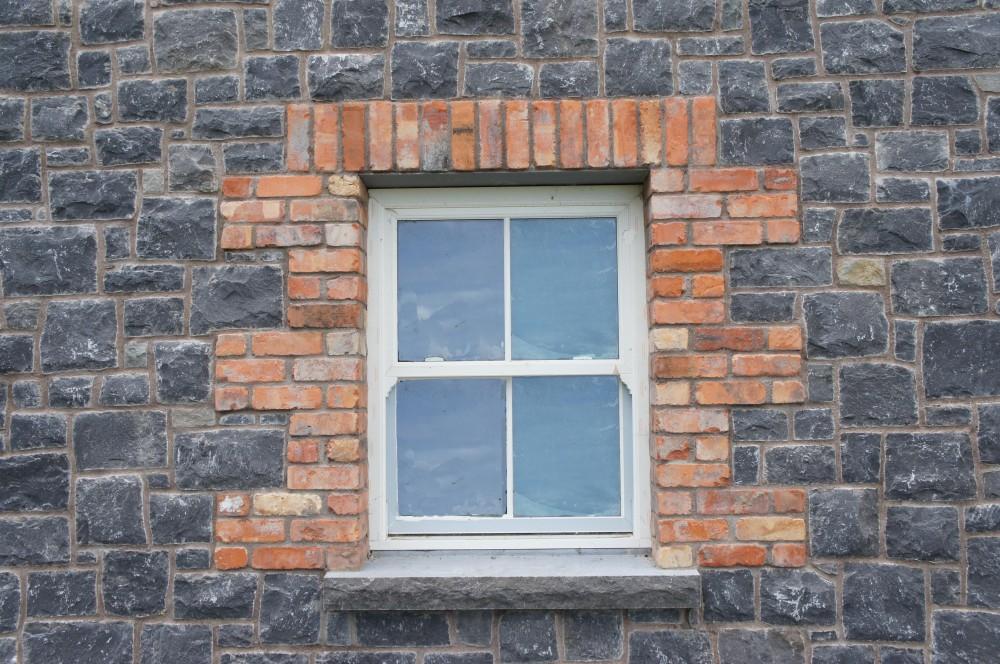 Red brick quoins built around windows